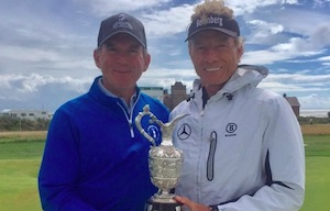 Chip Lutz poses with champion Bernhard Langer